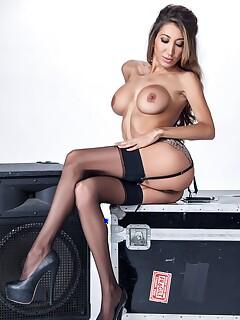 Fake titted brunette Krystin Hagen sheds lingerie & spreads leg to show cunt