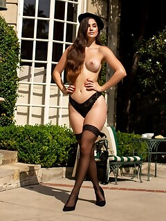 Artsy babe in black lingerie Rose flaunts her big naturals in the garden