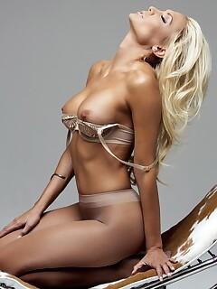 Centerfold Jennifer Vaughn strips lace bra & silky pantyhose to recline nude