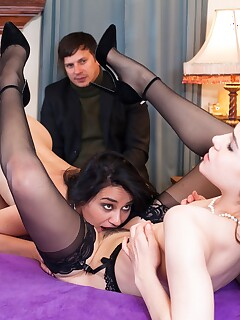 Gorgeous dark haired sluts in hot lingerie eat pussy in voyeur threesome
