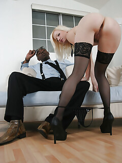 Sexy blonde in stockings is into interracial hardcore pounding
