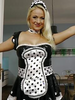 Big boobed blonde posing naked after doffing maid uniform