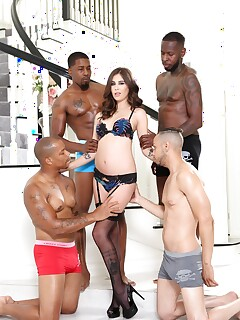 Beautiful MILF Kacie Castle takes on the big cock boys in interracial gangbang