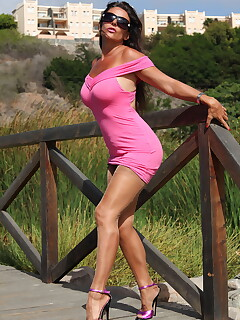 Sexy MILF Eve Miller outdoor in Pink
