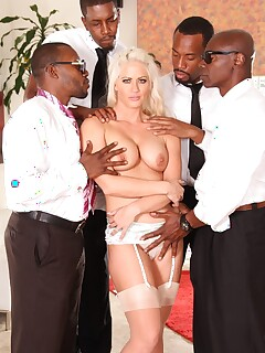 Blonde pornstar Holly Heart is ready to be fucked by four black men