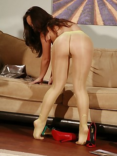 Small titted girl in yellow pantyhose and white high heels showing everything.