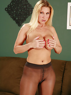 Busty pantyhose blond has nothing under them, everything is revealed on her as she masturbates.