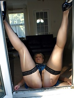 Slutty big ass mom in stockings spreads at her back door.