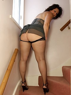 Curvy big butt MILF in pinstripe lingerie and fishnets.